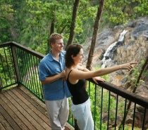 Journey past rainforest waterfalls, rugged mountains and towering ravines on this famous railway.