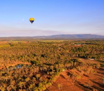 Glide gently over the bushlands & farms of the Mareeba Valley.